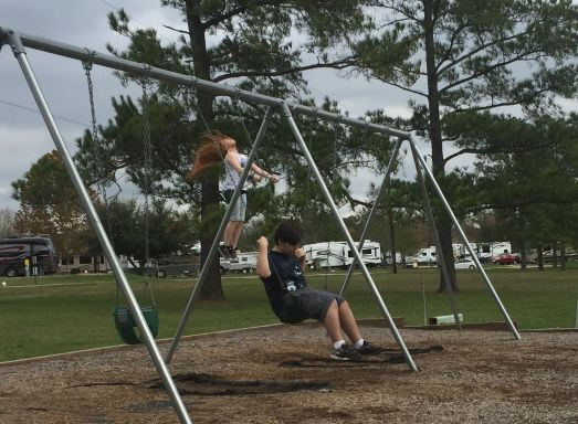 Abbie's hair flying on the swing